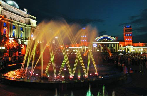 This is night view of local rail way station. Here you can observe beautiful fountain which looks like a real piece of creation and creates very positive atmosphere around.